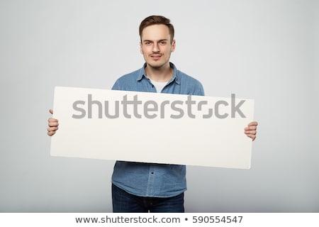 lezser · fiatalember · tart · lap · papír · mosolyog - stock fotó © deandrobot