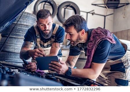 Car mechanic with a tablet Stock photo © fotoedu