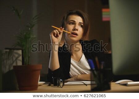 Koncentrált fiatal hölgy designer tart toll Stock fotó © deandrobot