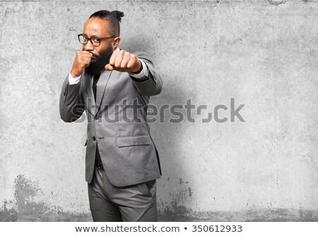 Furioso moço concreto parede jovem cara Foto stock © konradbak