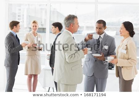 Vue de côté heureux homme d'affaires potable café parler Photo stock © deandrobot