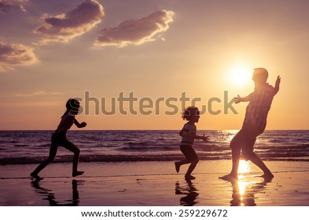 Father running with children by sea Stock photo © IS2