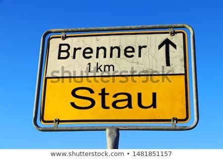 Trafik işareti gökyüzü imzalamak mavi siyah trafik Stok fotoğraf © latent