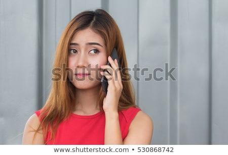 Confusi parlando cellulare immagine piedi Foto d'archivio © deandrobot