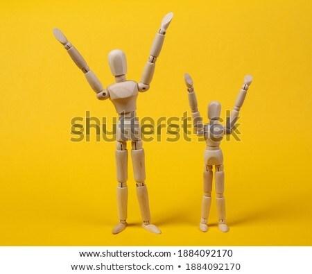 Wooden figurine standing with hands raised Stock photo © wavebreak_media