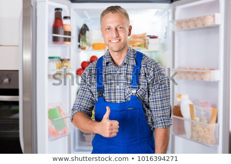 repairman showing thumbs up in the kitchen stock photo © andreypopov