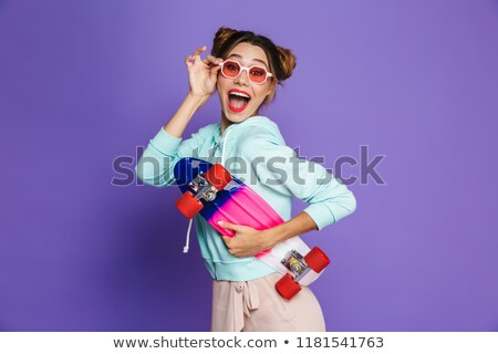 Portrait of excited hipster girl with two buns in sunglasses smi Stock photo © deandrobot