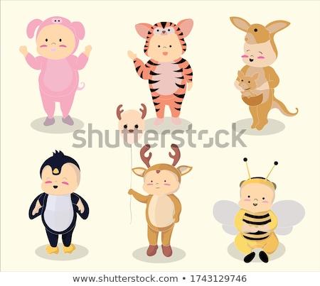 vector set of kids wearing animal suits stock photo © olllikeballoon