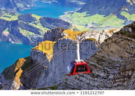 Stock photo: Mount Pilatus aerial cabelway above cliffs and Lake Lucerne land