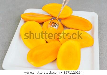 Közelkép lövés érett mangó szeletek leragasztott Stock fotó © vkstudio