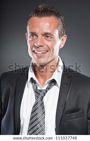 Attractive young blonde haired man in formal wear Stock photo © deandrobot