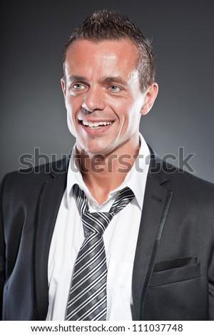 Vonzó fiatal szőke hajú férfi hivatalos visel Stock fotó © deandrobot