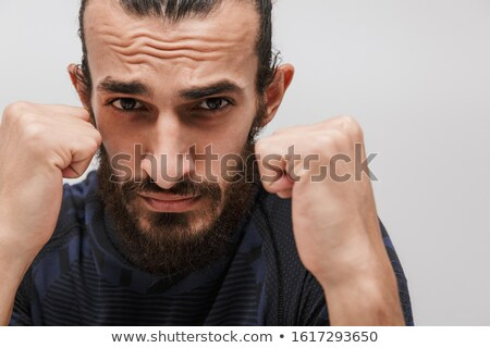Image of bearded brunette sportsman wearing tracksuit boxing at  Stock photo © deandrobot