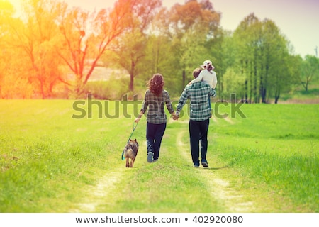 Family in park with child on shoulders Stock photo © Paha_L