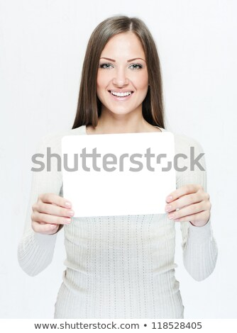 Smart woman holding a blank business card Stock photo © photography33