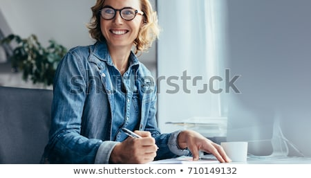 Employee at her desk Stock photo © photography33