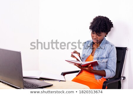 Smiling teenager holding her laptop with the screen in front of the camera Stock photo © wavebreak_media