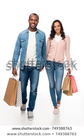 couple with shopping bags isolated on white stock photo © dacasdo