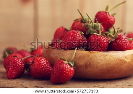 fresh strawberries in wood bowl  Stock photo © manaemedia