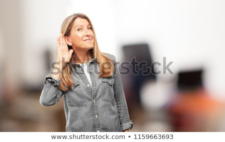 Mature woman trying to listen Stock photo © bmonteny