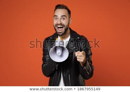 Férfi bőrdzseki hangszóró mosolyog zene mosoly Stock fotó © feelphotoart