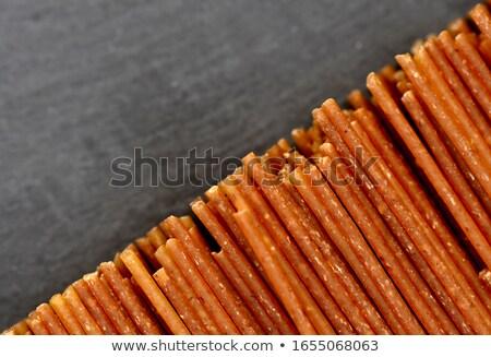 neatly lined with raw spaghetti Stock photo © OleksandrO