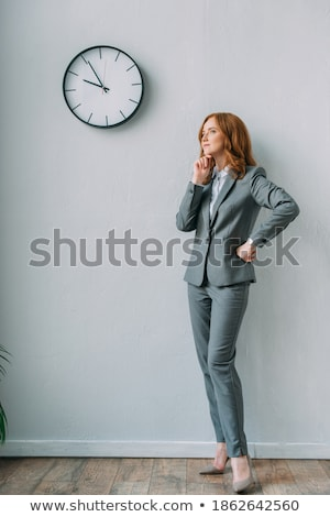 Stock photo: Redhead businesswoman standing with hands on hips