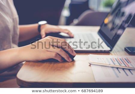 Businessman using mouse of computer Stock photo © wavebreak_media