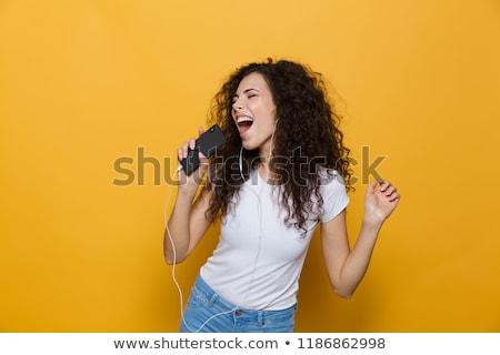 Szczęśliwy dość brunetka śpiewu mikrofon biały Zdjęcia stock © wavebreak_media