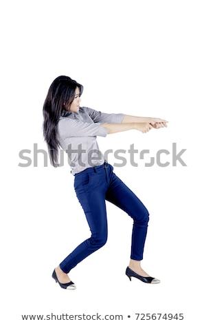 business woman pull something stock photo © fuzzbones0