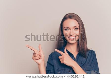 Stok fotoğraf: Gülümseyen · kadın · işaret · parmak · uzak · yalıtılmış · beyaz