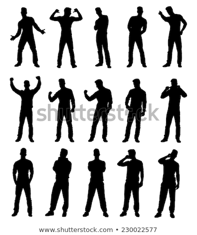 Cheerful excited young man standing with hands in pockets Stock photo © deandrobot