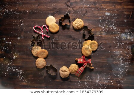 christmas tree made by cookies and cinnamon with christmas attributes on the white wooden table to stock photo © karpenkovdenis