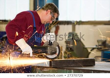 Mature male worker grinding metal in workshop Stock photo © stevanovicigor
