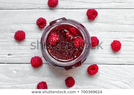 fresh raspberries and jam on wooden table stock photo © yatsenko