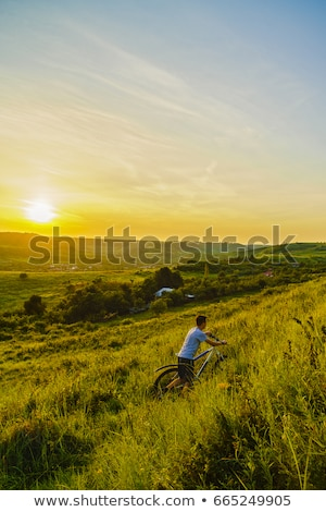 Stock photo: Young boy on hill in countryside