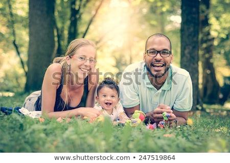 Félvér fiatal családi portré park szeretet nők Stock fotó © feverpitch