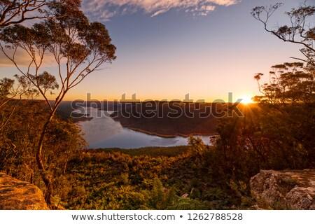 Naplemente festői tó kilátás nagy íny Stock fotó © lovleah