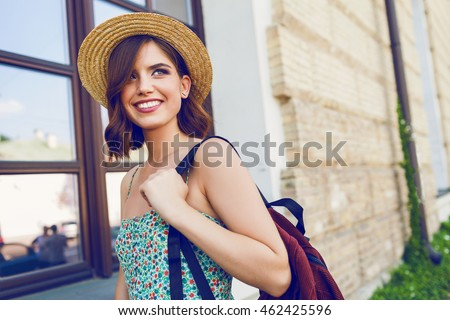 beautiful young woman wearing hat walking stock photo © deandrobot