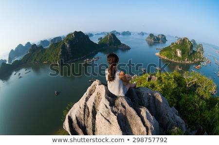 Traveler girl enjoying mountainous village view Stock photo © Anna_Om