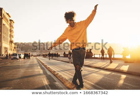 Moda adam yürüyüş şehir sokak yüz adam Stok fotoğraf © Lopolo