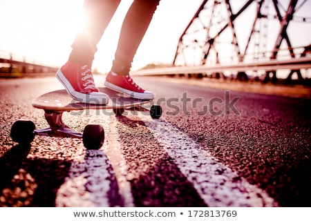 Teen on Skateboard, Girl Skating on Board Outdoor Stock photo © robuart