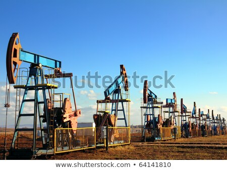 trabalhando · Óleo · silhueta · sol · céu · industrial - foto stock © mikko