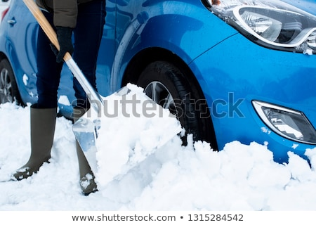 Motorist Digging Car Out Of Snow Stock photo © HighwayStarz