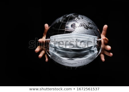 On black background little child hands holding globe covered wit Stock photo © amok