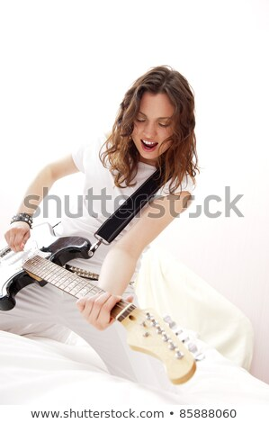 portrait of young pretty girl who is feeling free and playing gu stock photo © hasloo