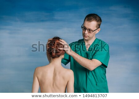 young female doctor auscultating an old woman Stock photo © photography33