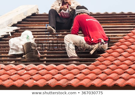Laborer changing tiles Stock photo © photography33