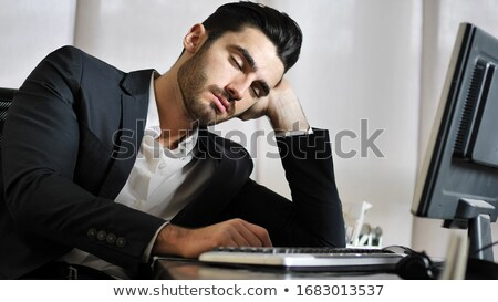 businessman resting in front of his computer stock photo © photography33