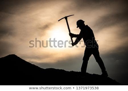 A man holding a pickaxe. Stock photo © photography33